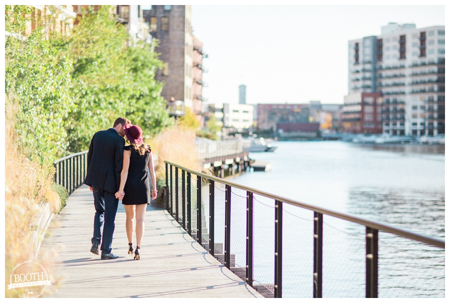 couple kissing along the lake walk of Milwaukee's Historic Third Ward