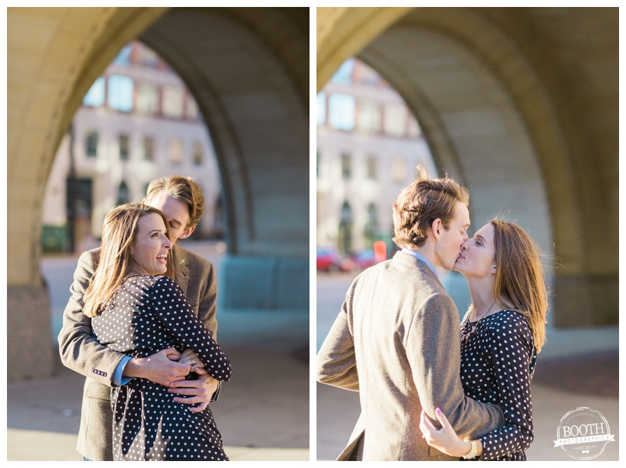 engaged couple dancing and kissing in front of City Hall in Milwaukee Wisconsin