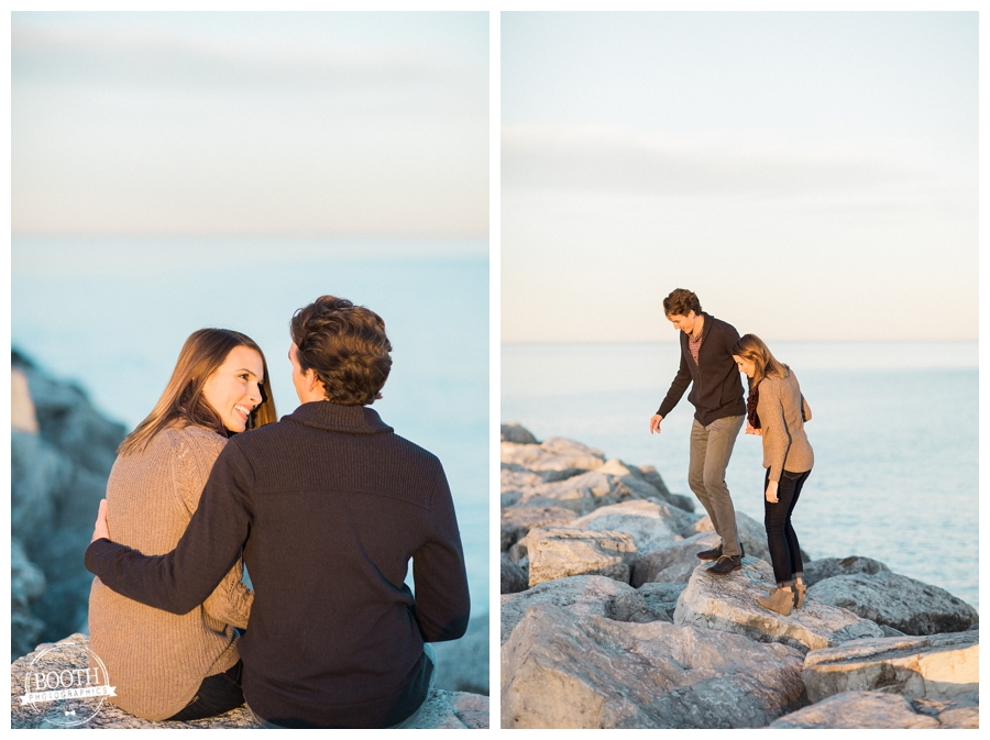 engaged couple walking along the rocks on Lake Michigan n Milwaukee Wisconsin