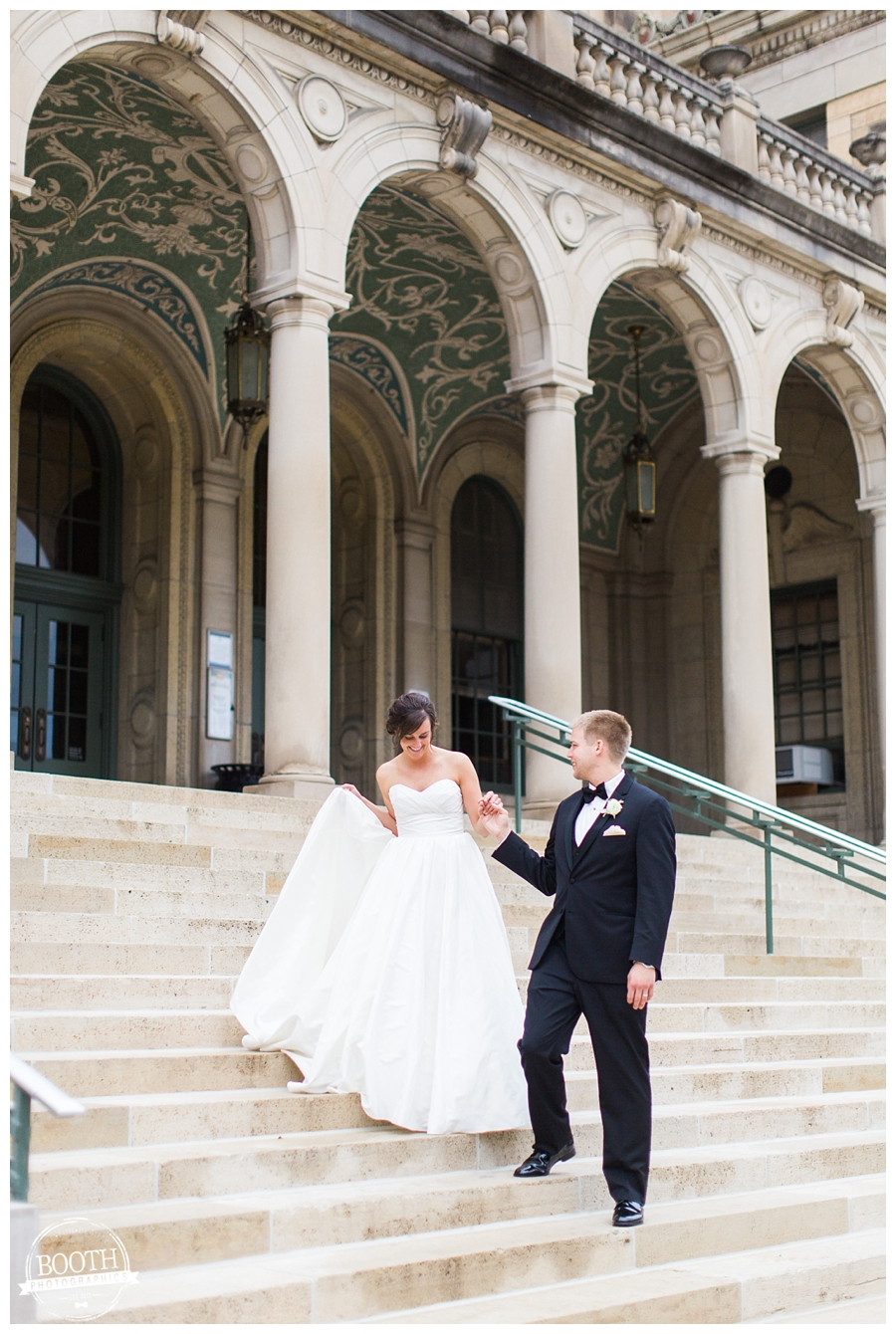 bride and groom on the front steps of the UW memorial union at their elegant wedding