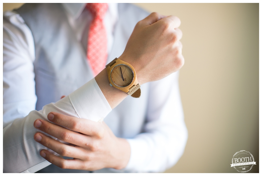 groom wearing the watch his future wife bought him for their wedding day