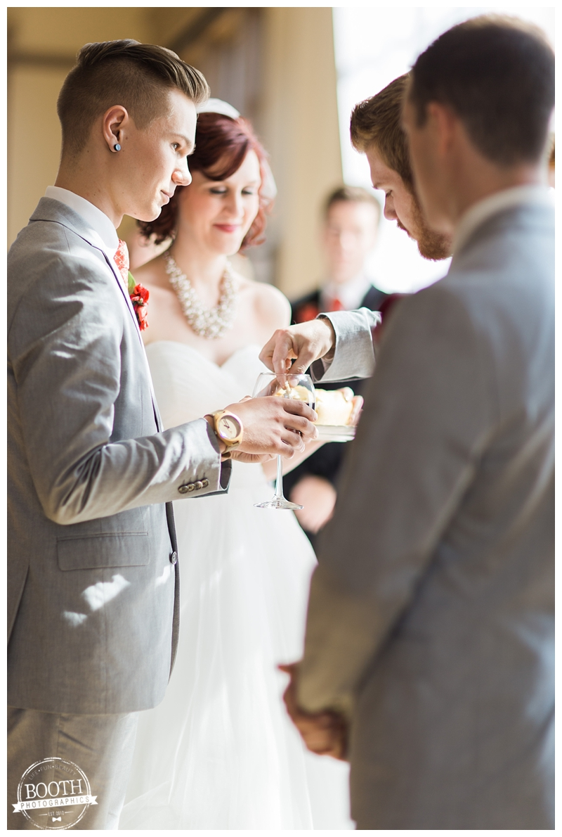 bride and groom serving communion to their bridal party during their wedding ceremony