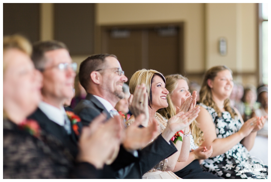guests clapping for the bride and groom at their wedding at Noah's in Naperville