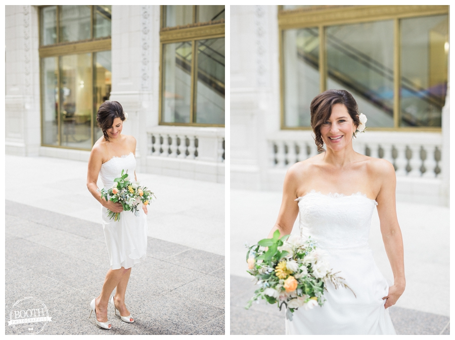 bride enjoying her wedding in downtown Chicago as she dances atthe Tribune Tower