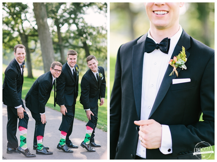 groomsmen showing off colorful socks