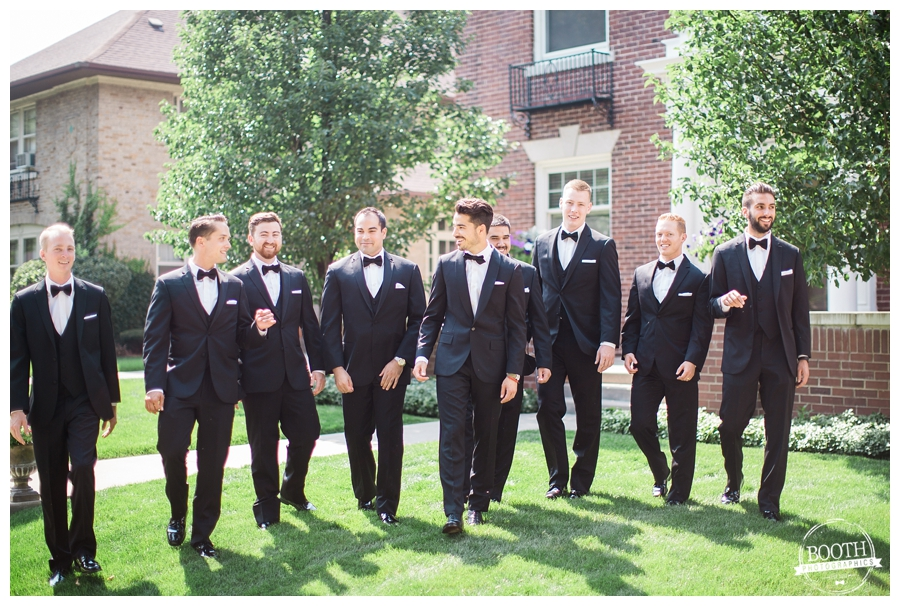 groomsmen walking to the ceremony at a Milwaukee private estate wedding