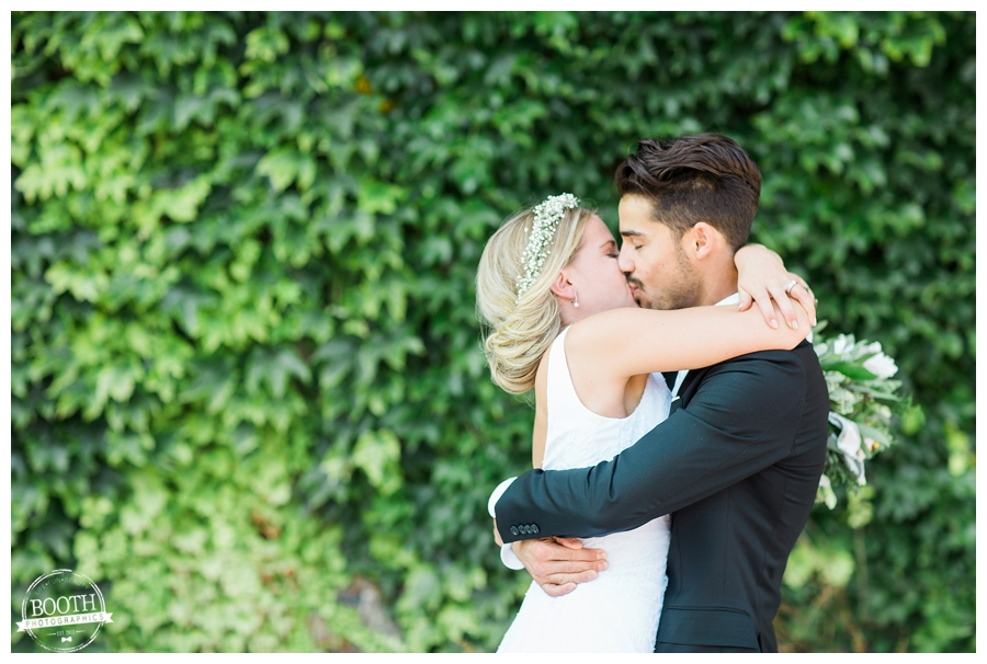 bride passionately kissing her groom at a Milwaukee Pritzlaff wedding