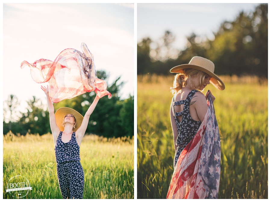 model Jenna Dickson posing in a field holing an American flag scarf wearing a blue romper