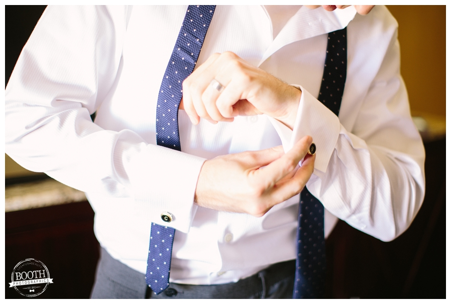 groom putting his cuff links on for a wedding at the Walnut Grove in Moorpark, CA