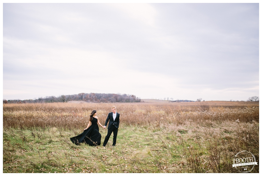 editorial photo of a classy couple walking across a field in Governor Nelson State Park in Madison, WI