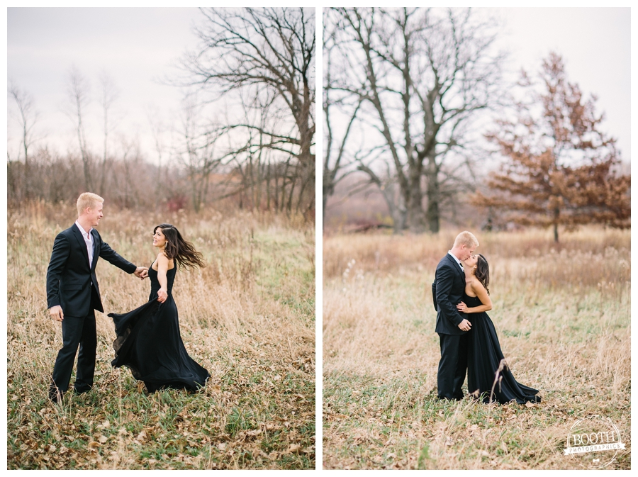 man in a suit and woman in a black ball gown dancing through a field  in Madison , WI