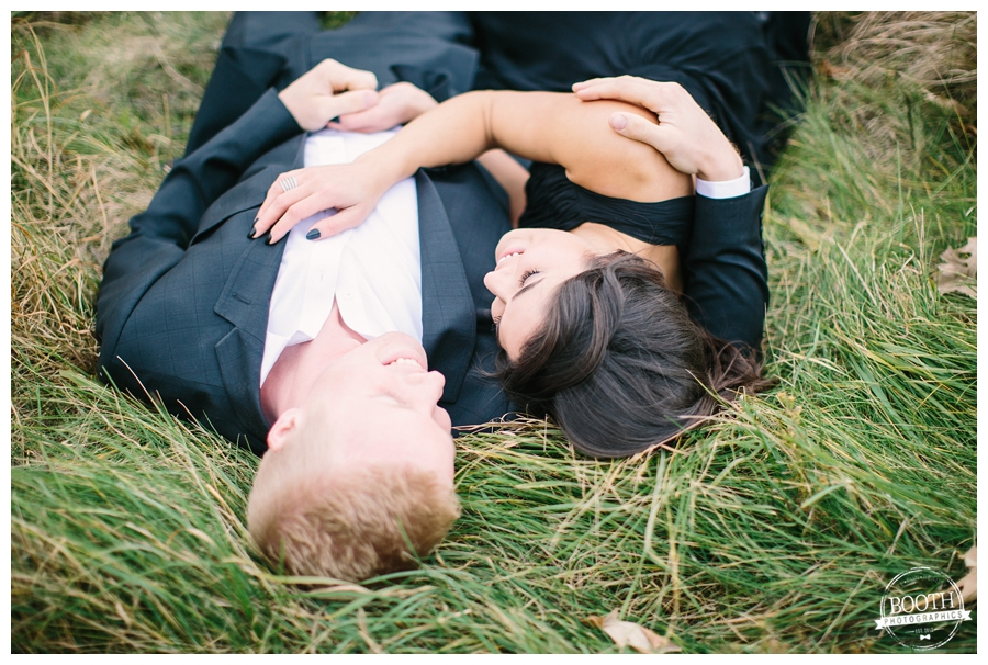 dressed up couple laying in a grassy field in Governor Nelson State Park Madison, WI