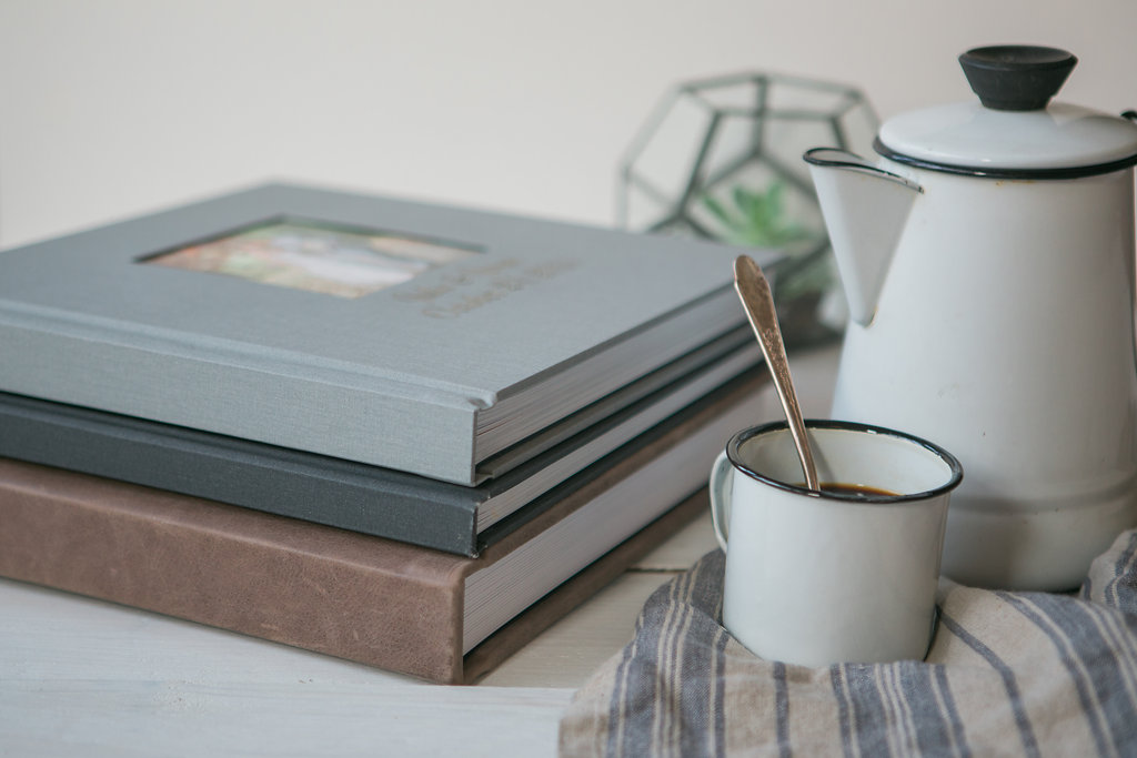 linen and tuscan leather kiss books album on coffee table