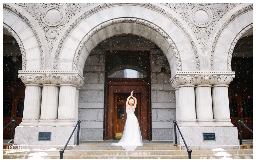 Milwaukee Bride in a BHLDN wedding dress standing in a stone archway