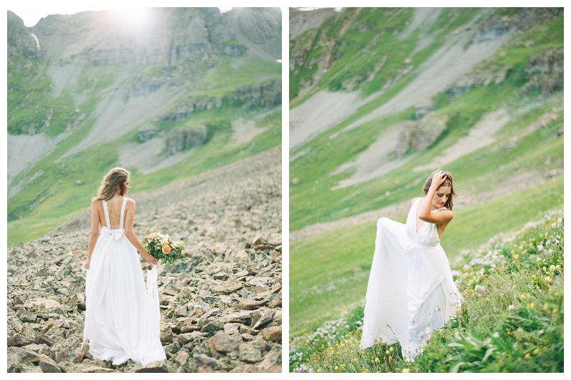bride walking along a mountain skree in her Truvelle gown photographed by Booth Photographics, destination fine art wedding photographers in Durango, CO