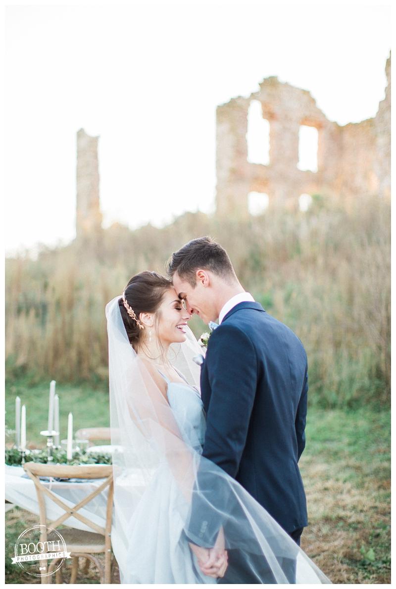 blue gray european wedding at a stone farmstead ruins at sunset