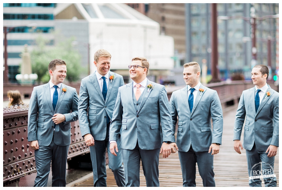 groom smiling with his groomsmen on Lurie Bridge in downtown Chicago