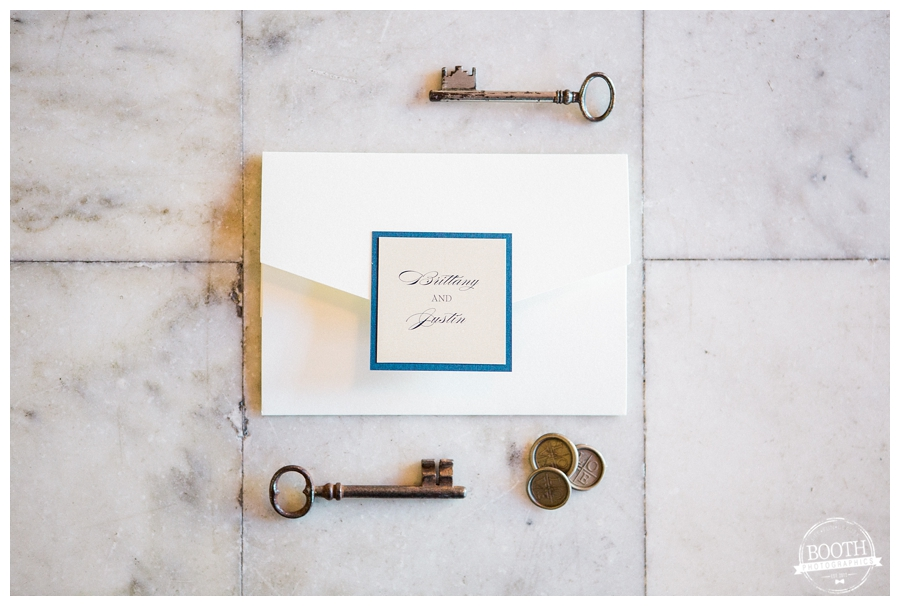 navy and cream letterpress wedding stationary on marble backdrop at Chicago Symphony Orchestra