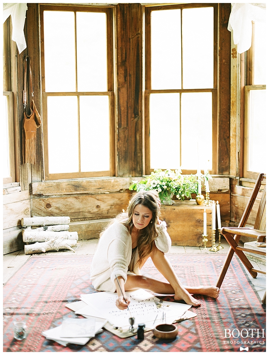 bride sitting on floor painting in her Colorado boudoir session by fine art film photographers, Booth Photographics