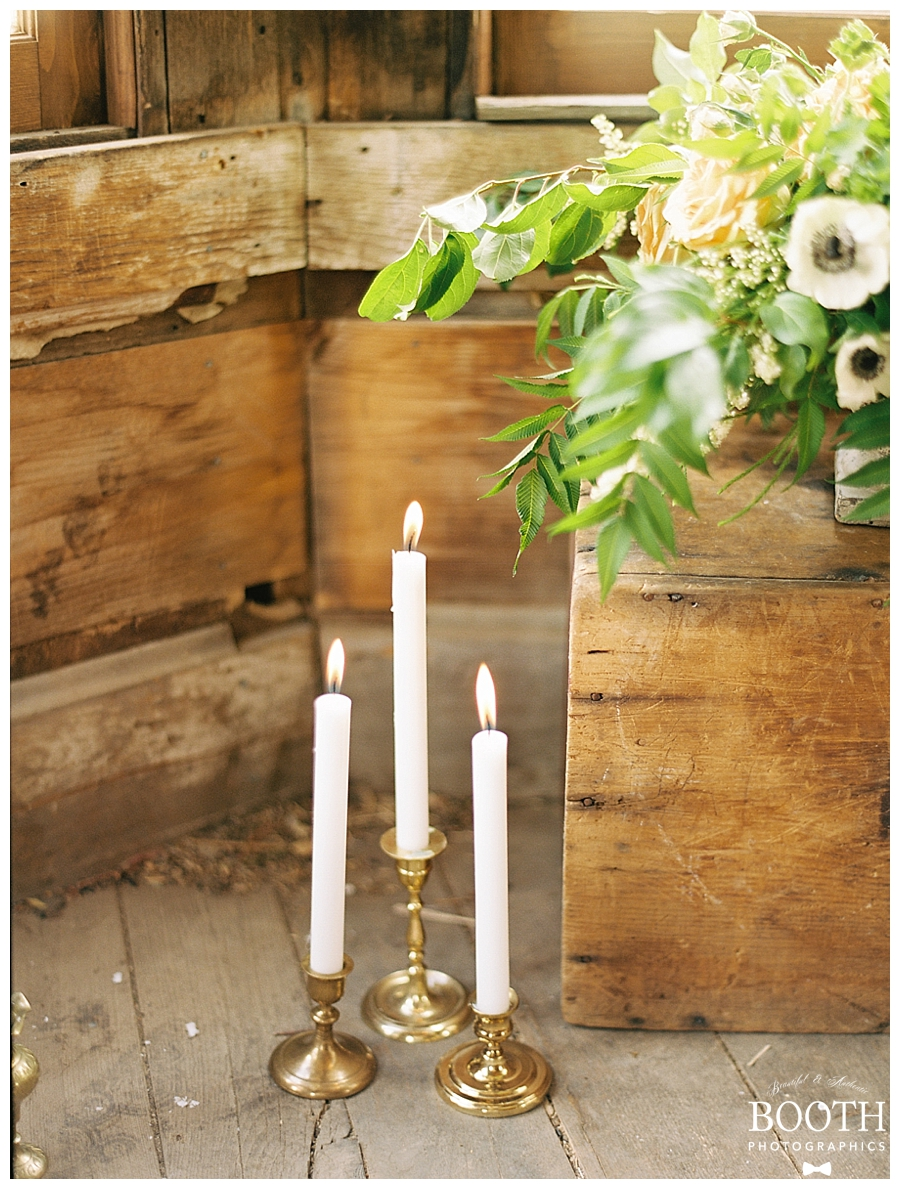candles in a rustic cabin in the Colorado Rocky Mountains by destination fine art film photographers, Booth Photographics