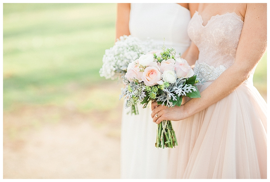 Bride wearing blush and bridesmaids wearing white at her rustic fall outdoor wedding