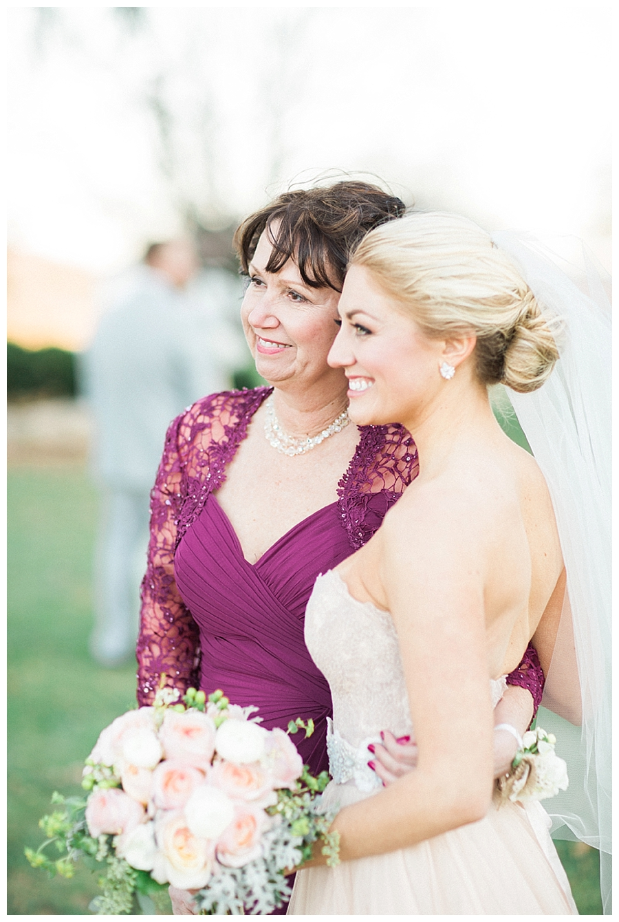 bride hugging her mother at her rustic outdoor fall wedding ceremony at Sugarland Barn