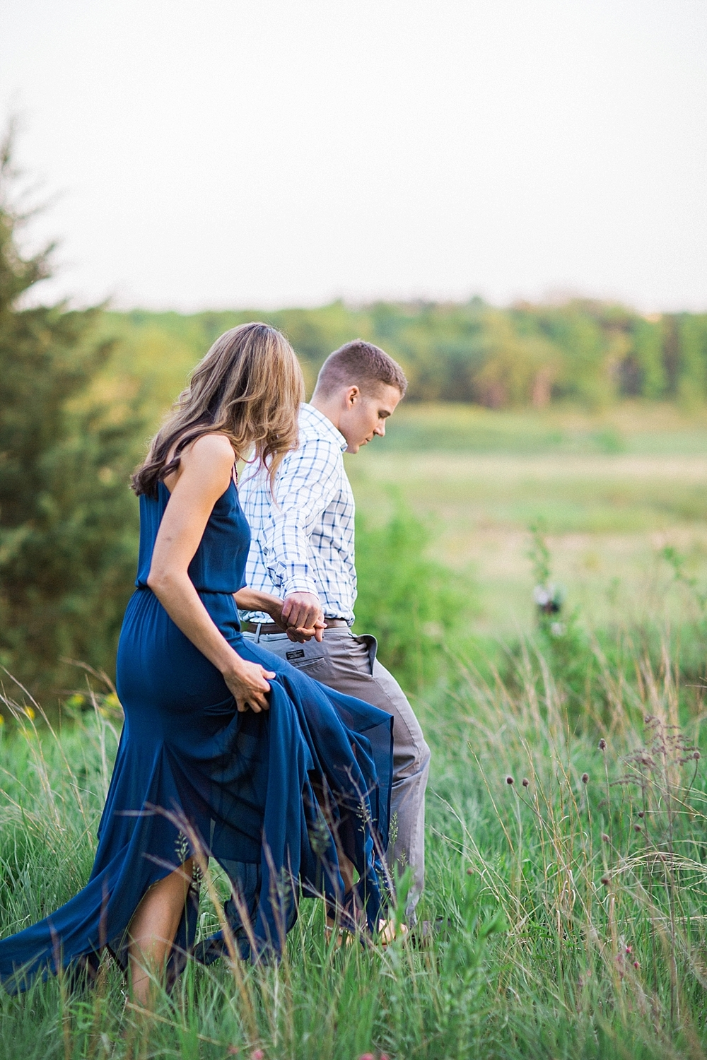 fine art engagement photography in a field