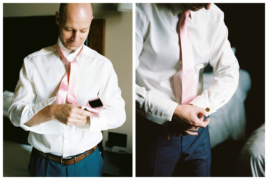 fine art photography of groom getting ready