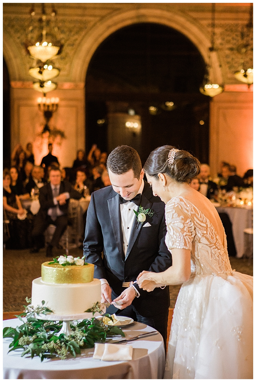 fine art wedding photography of cake cutting at the Chicago Cultural Center, Chicago