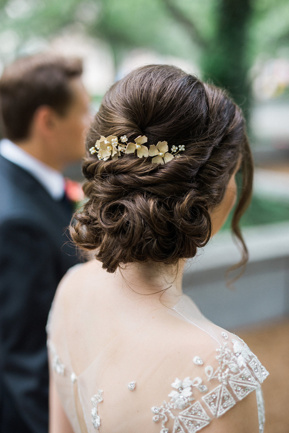romantic and curly chignon for a garden wedding at Artifact Events