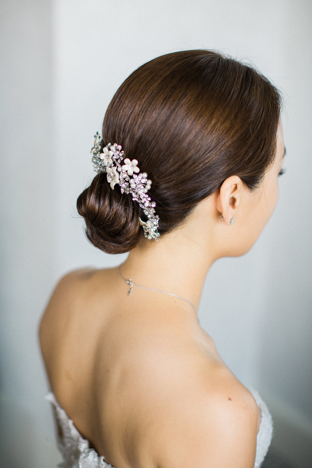sleek low bun with a Twigs and Honey hairpiece for a Villa wedding in Florence, Italy