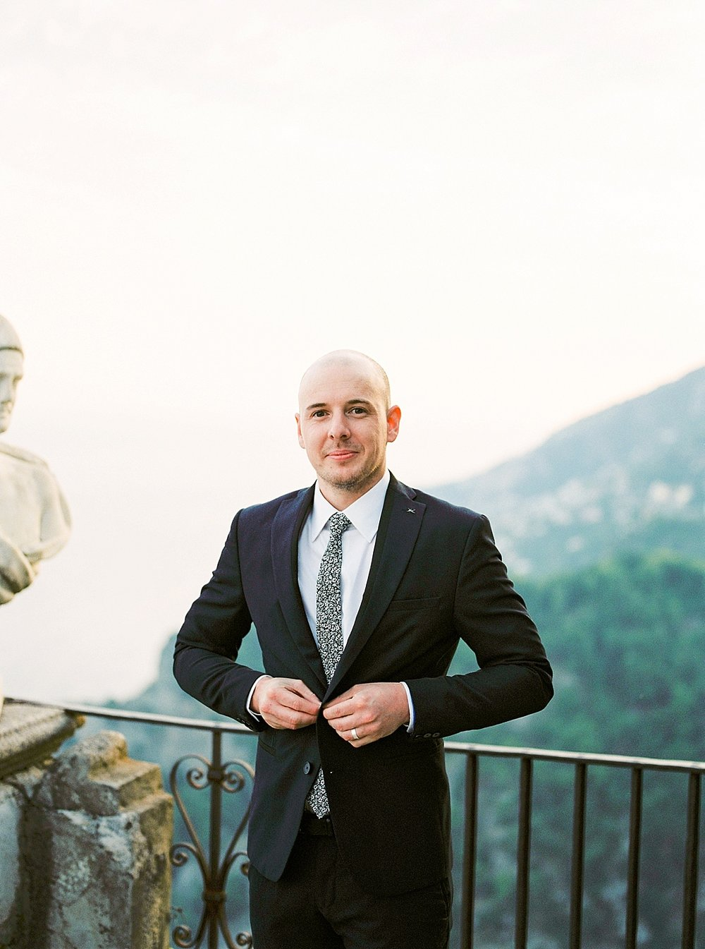 groom in custom trim fit suit in Ravello Italy for their destination elopement at Villa Cimbrone in Ravello, Italy