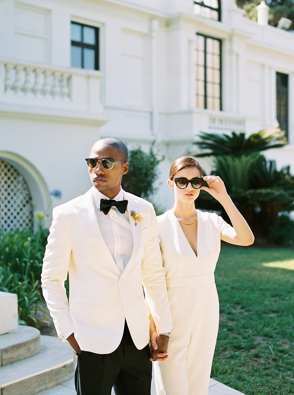 Groom with mid-century modern style in gogosha optique sunglasses for his wedding at Fenyes Mansion in Pasadena, California