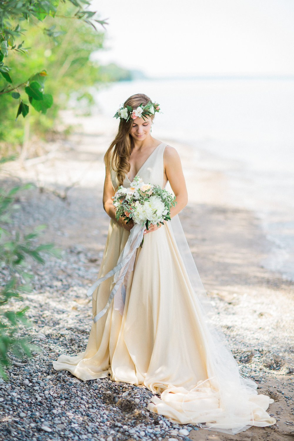 Bride wearing gold Carol Hannah Azurite gown on the shores of Lake Michigan