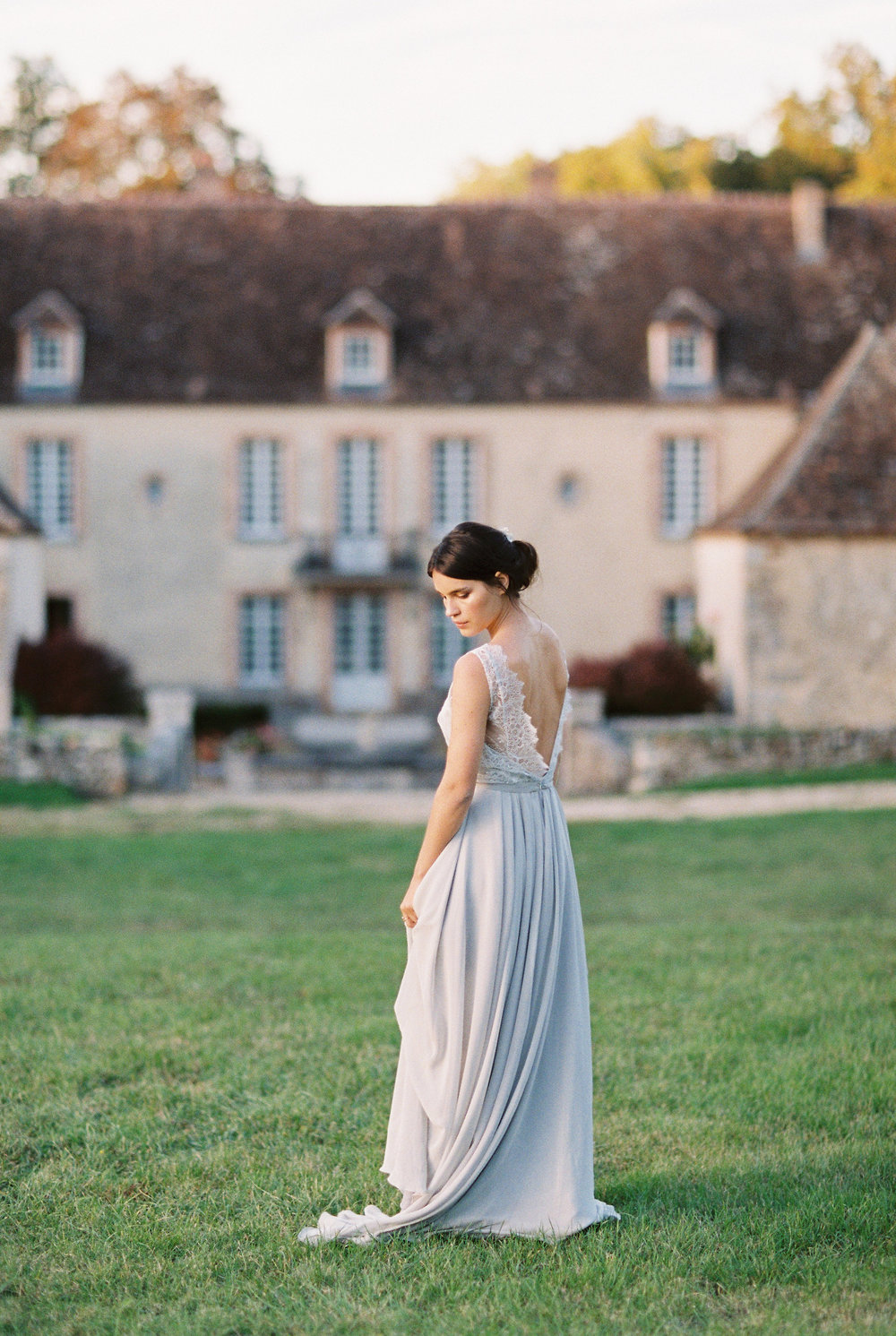 Bride wearing custom blue wedding gown by MoniRose Bespoke Gowns at her destination French chateau wedding in Burgundy, France