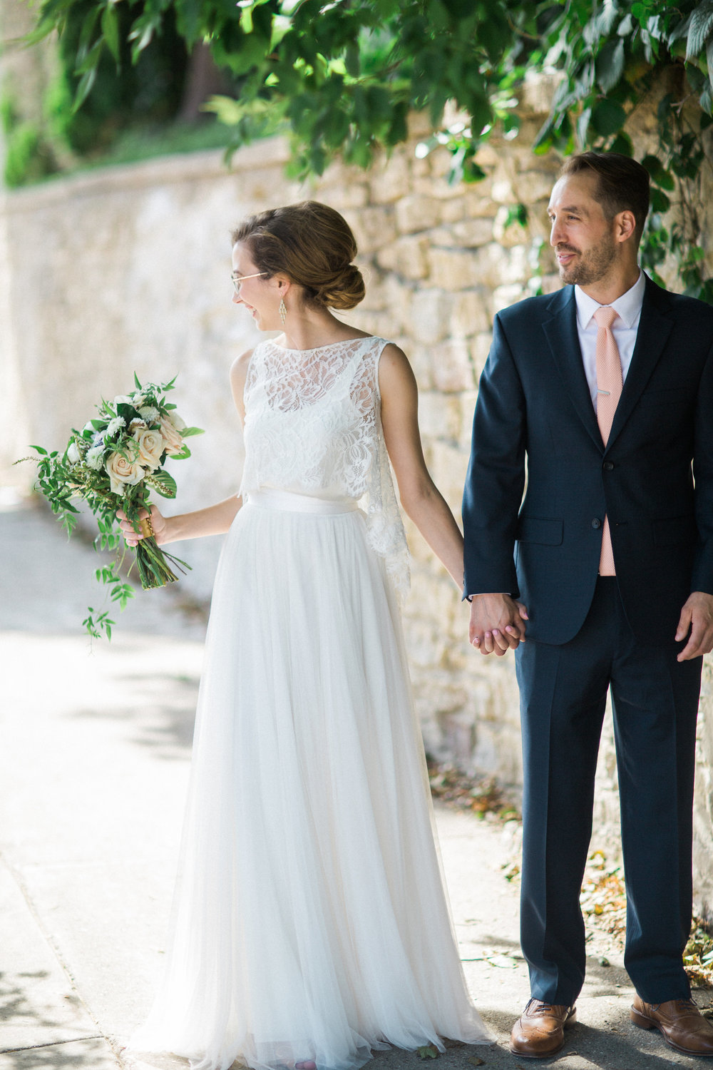Bride wearing BHLDN bridal separates for her brick warehouse wedding at the Lageret