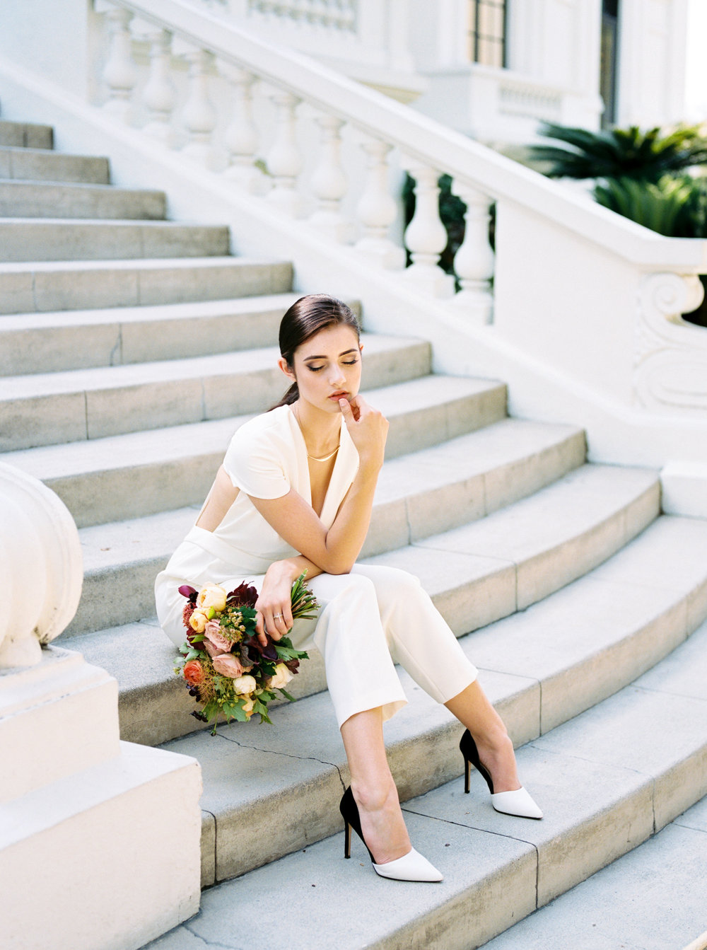 Bride wearing Delphine Manivet pantsuit for her private estate wedding in Pasadena, California