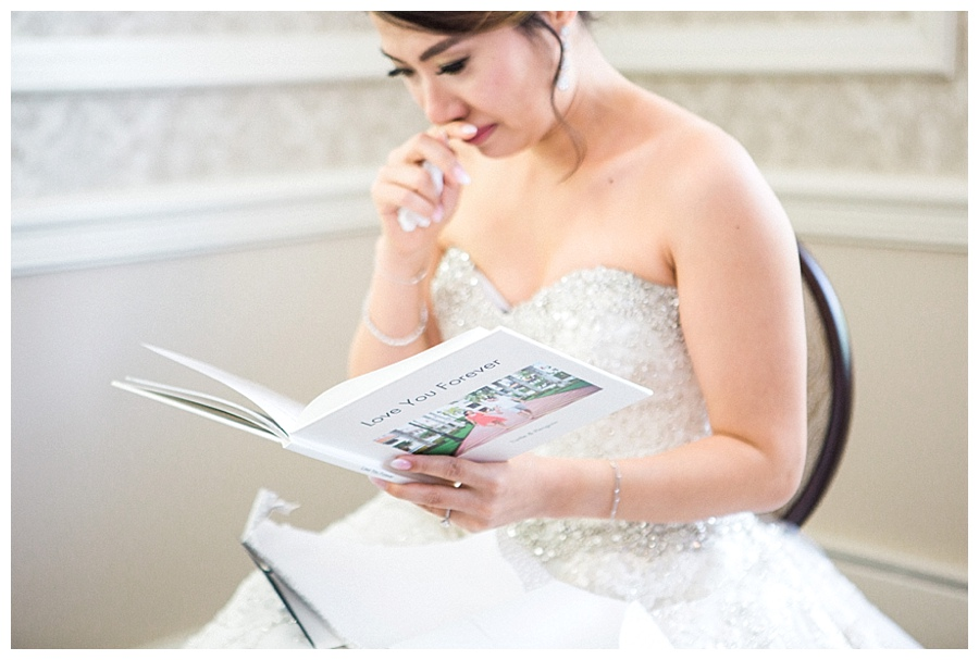 emotional bride reading a card from her groom