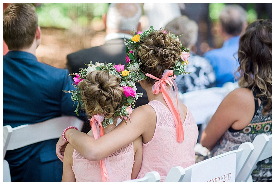 flower girls hugging each other at outdoor wedding ceremony at the Farm at Dover