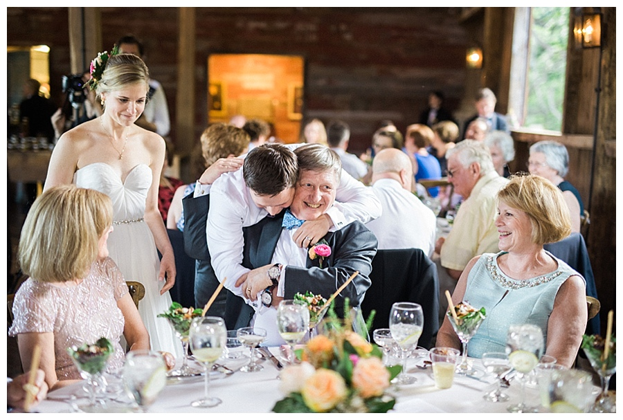bride and groom hugging family at their farm to table style wedding reception at the Farm at Dover