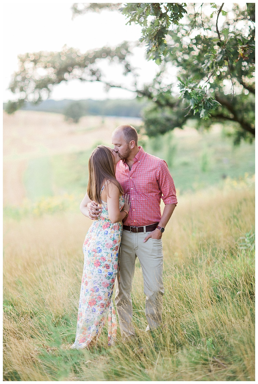 Couple hugging for their engagement session at Pope Farms Conservancy