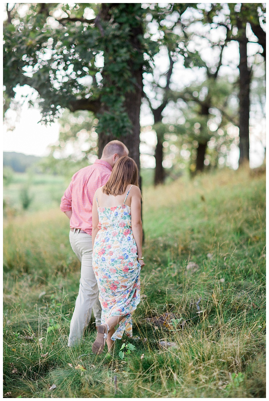 Couple walking together for their engagement session at Pope Farms Conservancy