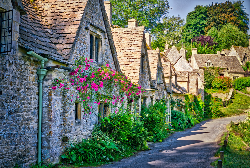 Arlington Row, Bibury, Cotswolds AONB, England, UK. Sony A7rII, Sony/Zeiss 55mm f/1.8 at f/8, three bracketed exposures 0, -2, +2. Edited using Lightroom, Aurora HDR Pro, MacPhun Intensify, and Photoshop.