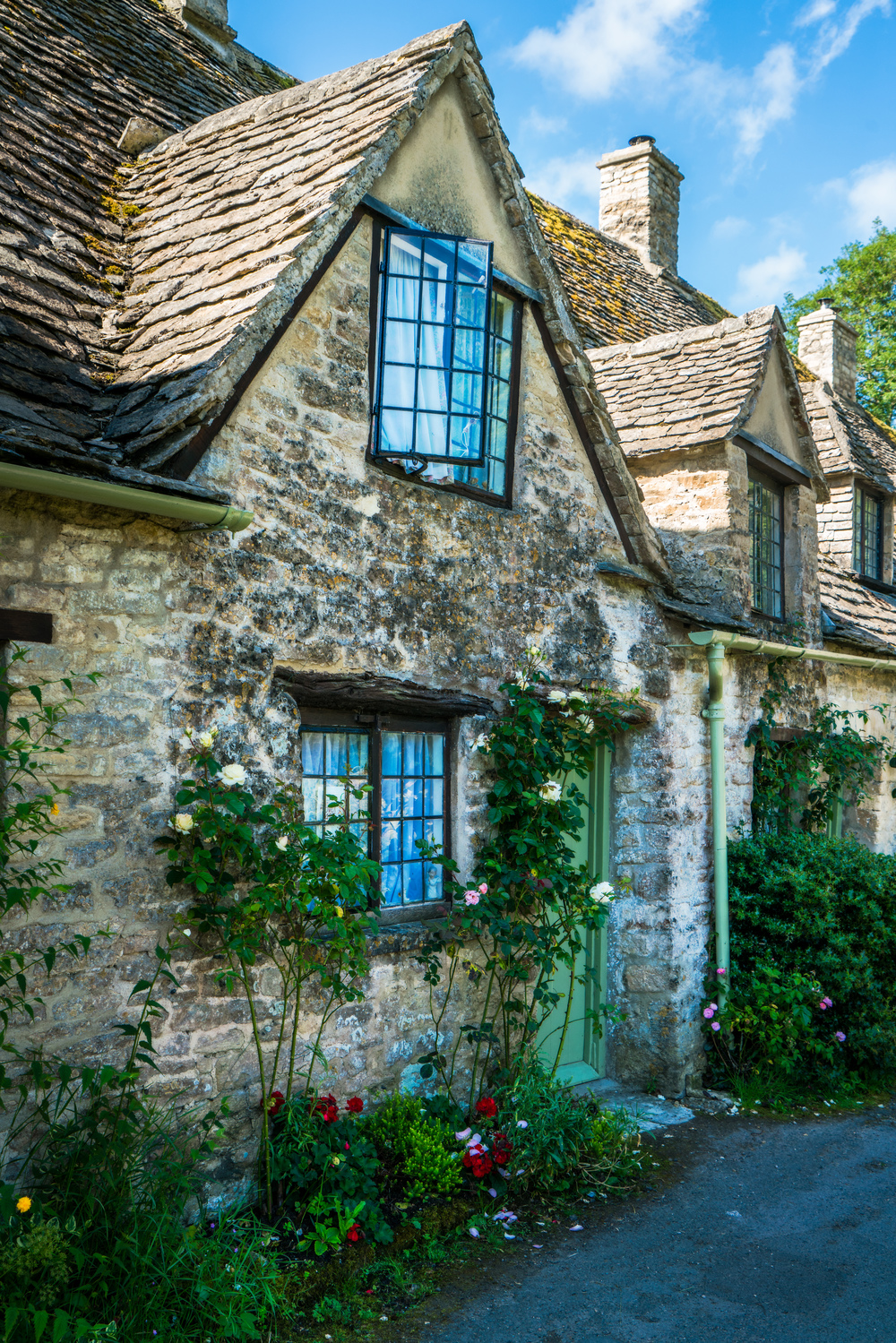 Arlington Row, Bibury, Cotswolds AONB, England, UK. Sony A7rII, Sony 24-70mm f/4 at 34mm, ISO 250, f/8, 1/125th. Edited in Lightroom and Photoshop.