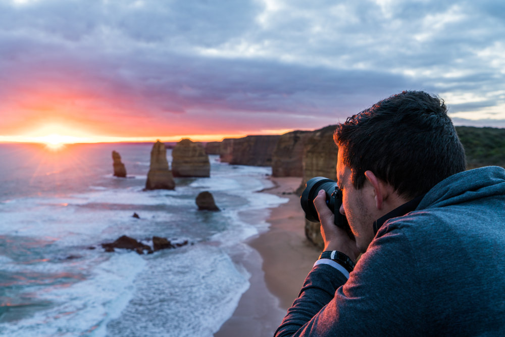 Fineas photographing Twelve Apostles sunset