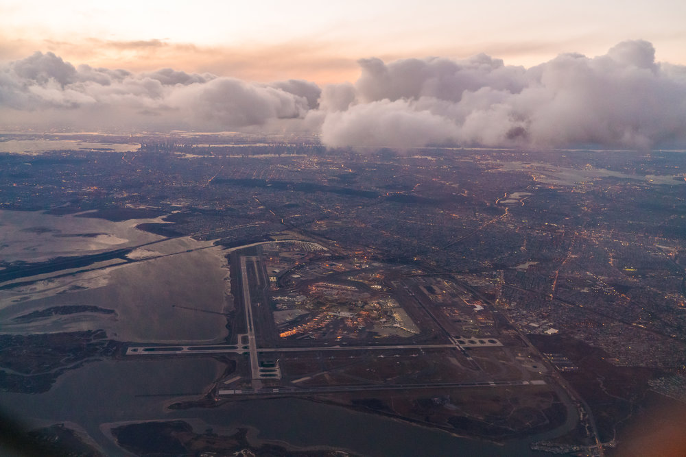 JFK Airport in the foreground, Queens, Brooklyn, and Manhattan receding into background