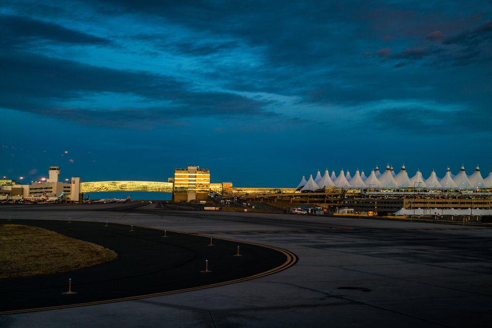 The shining Denver airport in the sunset