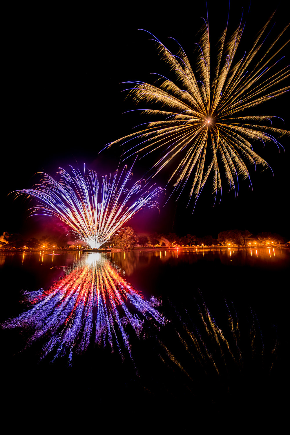 Sterling, KS - 4th of July Fireworks over the lake (2015)  Sony A7r, 10-18mm lens (APS-C lens in full-frame mode) at 13mm, f/5, 5 seconds, ISO 100.