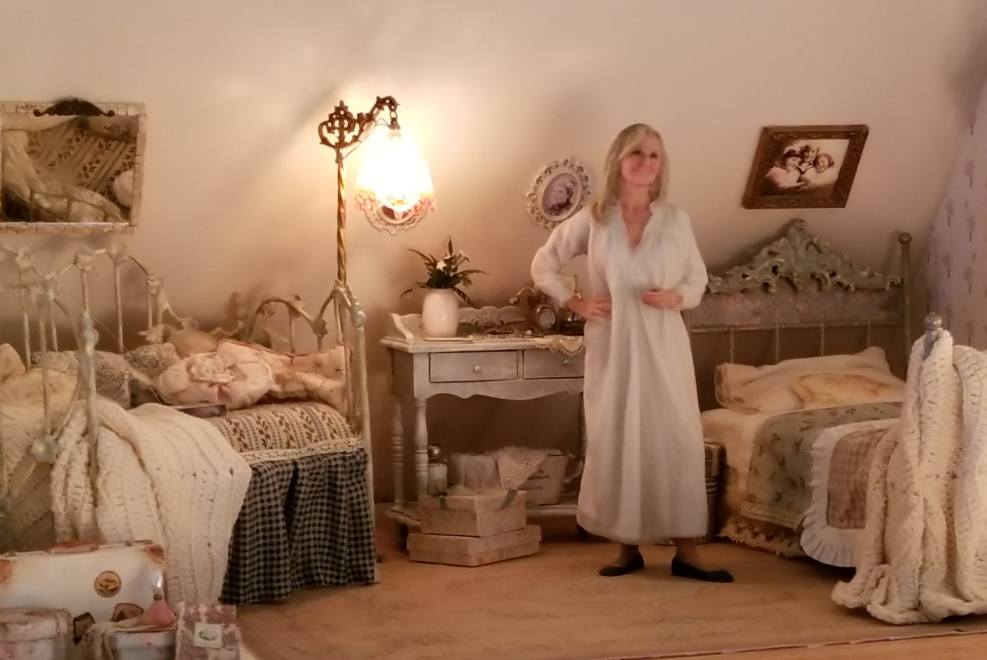 Betsey Reno looks great in this bedroom. Dressing in a costume really helps make this look real! Betsey got these cute items of furniture in Philly.