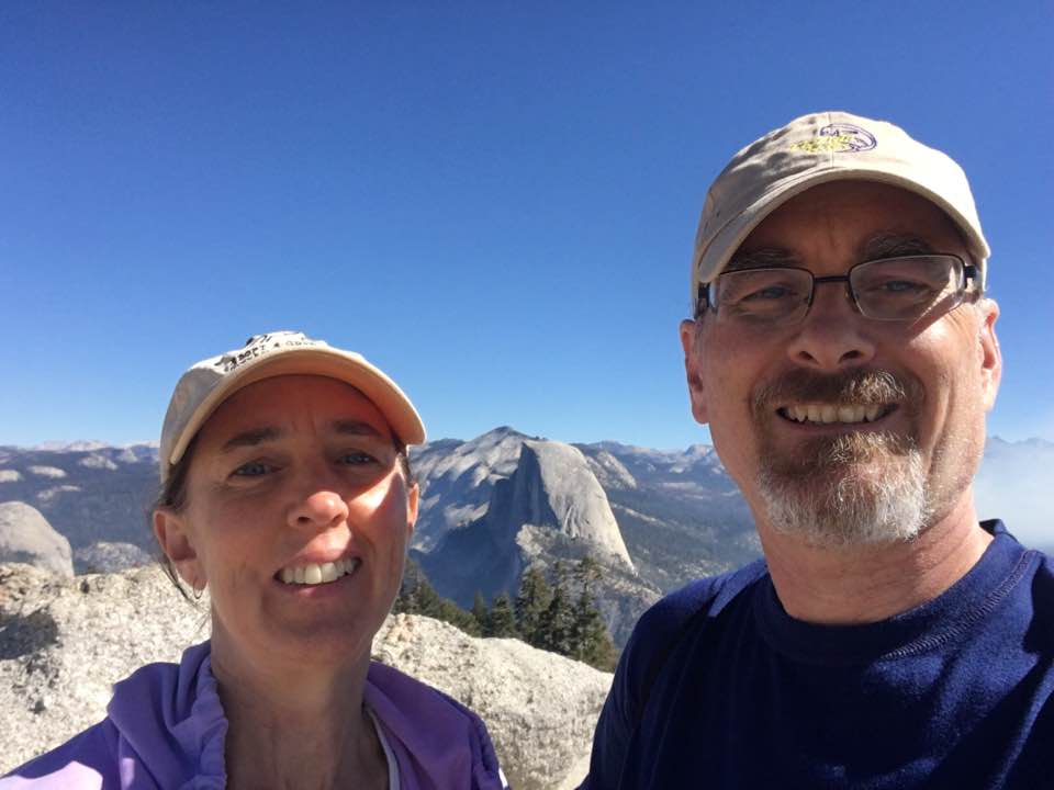 Dale and Donna at Glacier Point with view of Half Dome